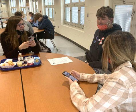 Seniors Rhyenn Todd, Connor Kinney and Ashley Shannon discussing Trenton Talk at lunch.