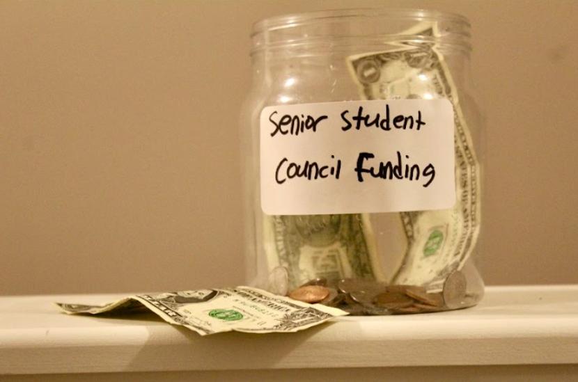 Despite Principal Geygan clearing their debt, the senior class still has little money.