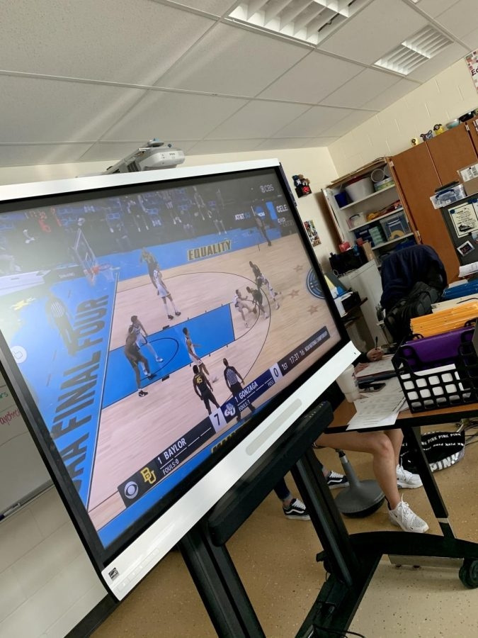Mr. Chasteen turned on the March Madness games for his students to watch while doing their work.