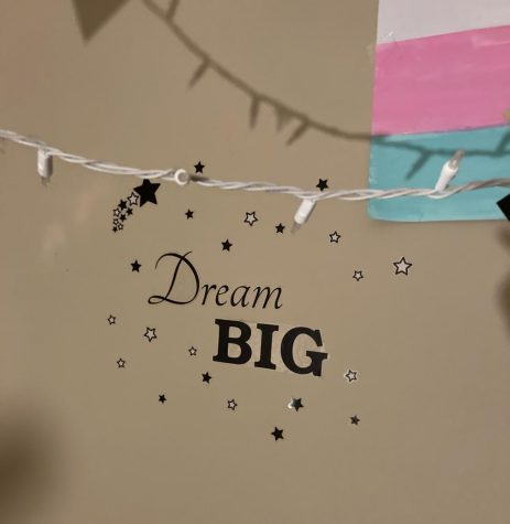 Sophomore Talin Edwards has a Dream Big sticker in their room, as well as a trans pride flag. (Photo contributed by Talin Edwards)