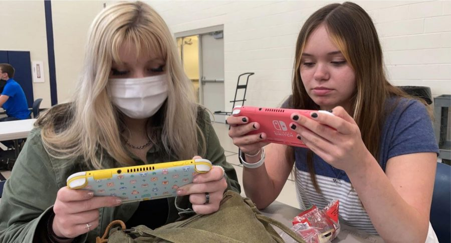 Juniors Mia Moore and Makhaila Hopkins enjoy playing video games in their spare time, even at school.