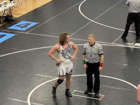 Radical discusses things with an official at the OHSAA State Championships. (Photo contributed by Greg Brown)