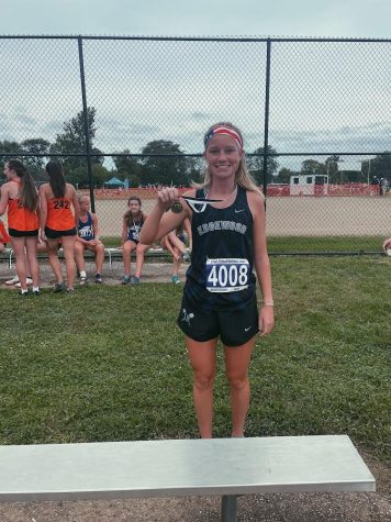 Photo taken by Coach Garver of Ashlynn as she placed 7th at the Neal Charske Invitational on September 25th, 2021.