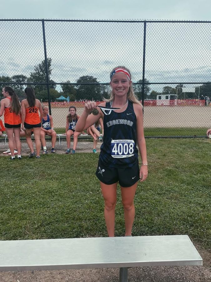 Photo+taken+by+Coach+Garver+of+Ashlynn+as+she+placed+7th+at+the+Neal+Charske+Invitational+on+September+25th%2C+2021.+
