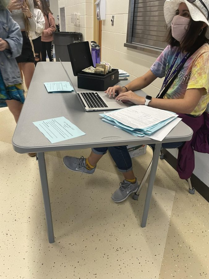 Ms. Anderson doing double duty selling HOCO tickets while participating in spirit week.