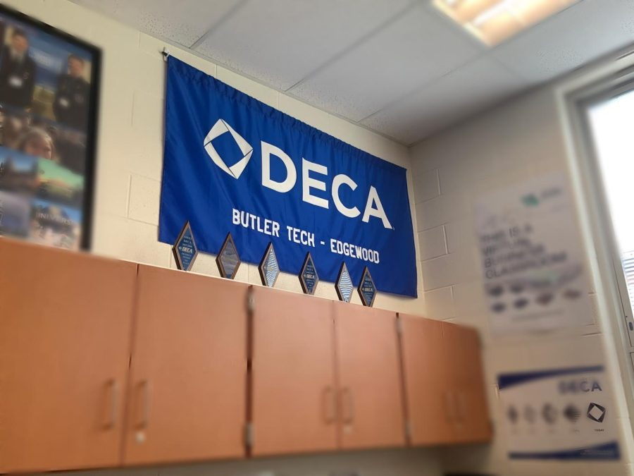 The+DECA+flag+and+trophies